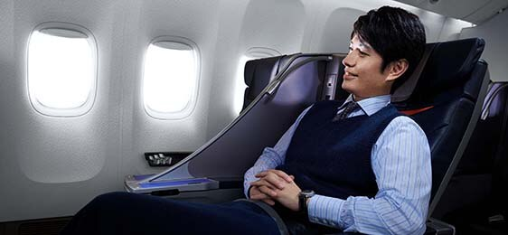 a man relaxing on airplane seat