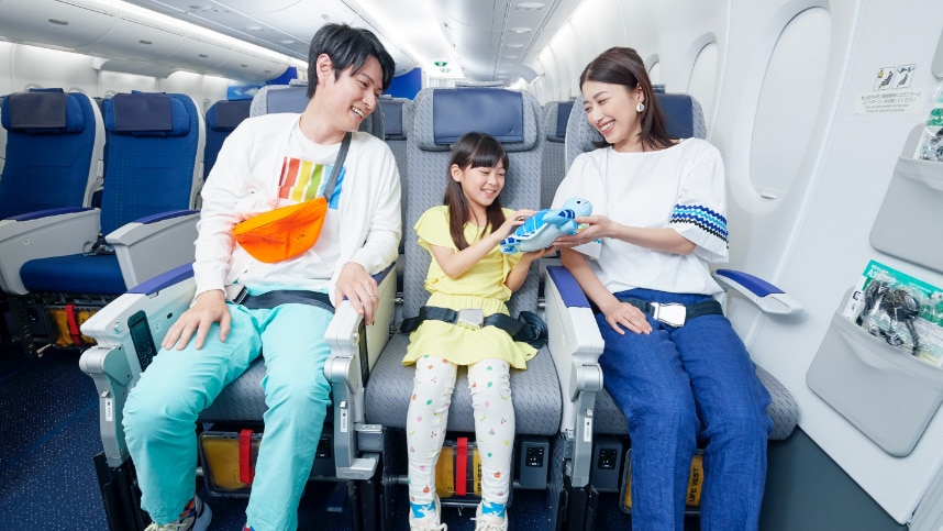 a family seating on ANA's economy class